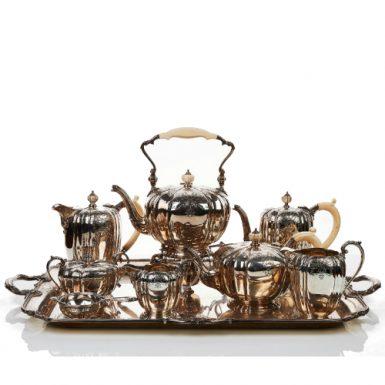 Elizabeth II Nine Piece Sterling Silver Coffee and Tea Service